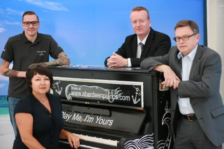 From right to left – Lewis Gibbon from John Bell Pianos, Sally Reay from Play Me I'm Yours, Adrian Watson, chief executive of Aberdeen Inspired and Ken Milroy, chief executive of Aberdeen Foyer.