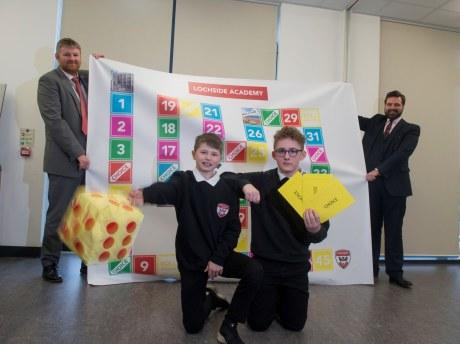 Lochside head teacher Neil Hendry, board game creator Sean-Paul Gordon and Kai McLaughlin (both 13 years old) and Councillor John Wheeler