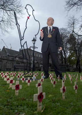 The Lord Provost of Aberdeen Barney Crockett is pictured in the Kirkyard at the Kirk of St Nicholas Uniting to see 'Tommy' and Remembrance crosses with the names of those listed on First World War memorials within the Kirk