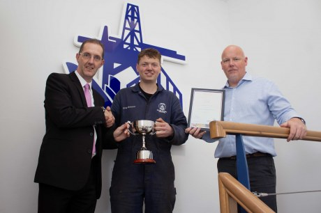 Greg Brimner receives his award from Jim Booth, training executive at Tullos Training and Michael Milne, managing director of Dales Marine Services